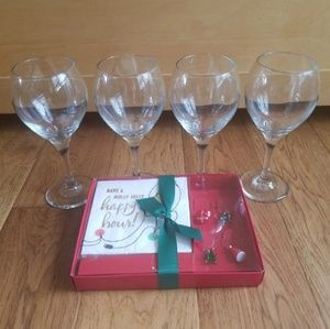 Four Wine Goblets and Accessories